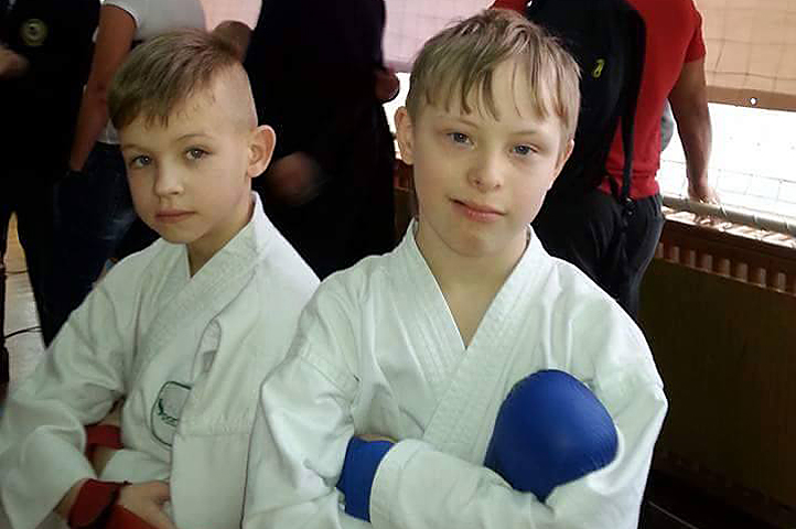 Denis and friend Matvey with boxing gloves