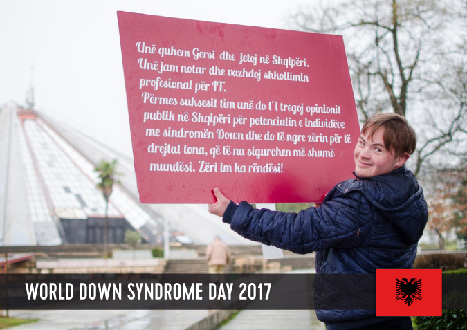 Young man with Down syndrome holding a sign with his statement to WDSD 2017.