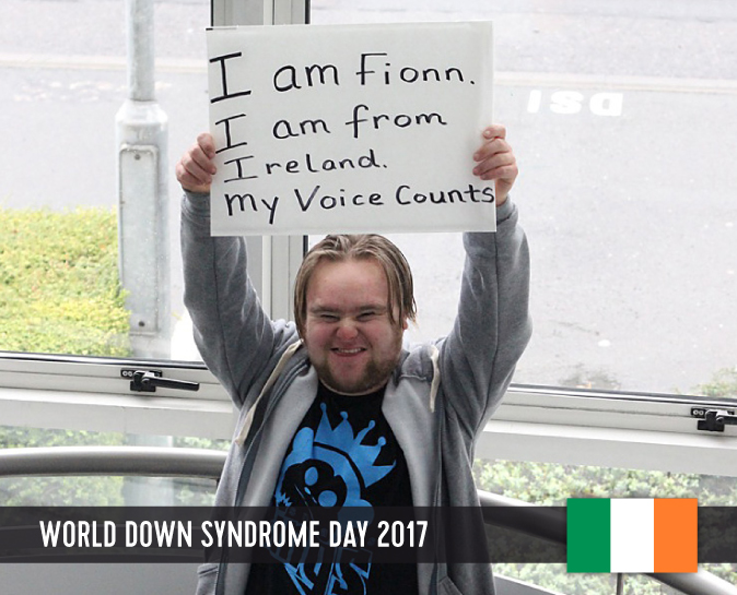Young man with Down syndrome holding a sign above his head with his statement to WDSD 2017