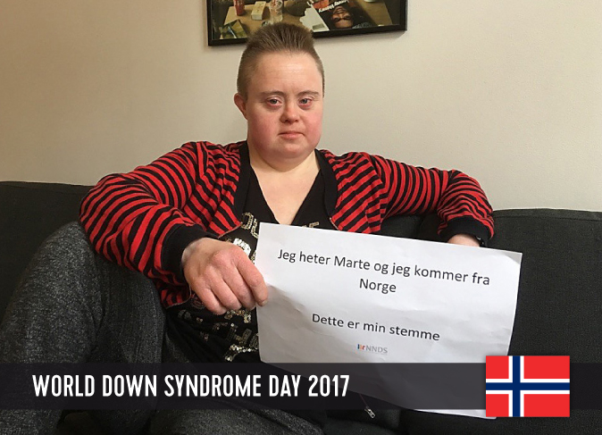 Young Norwegian woman with DS with a sign in her hands, showing her statement for WDSD 2017