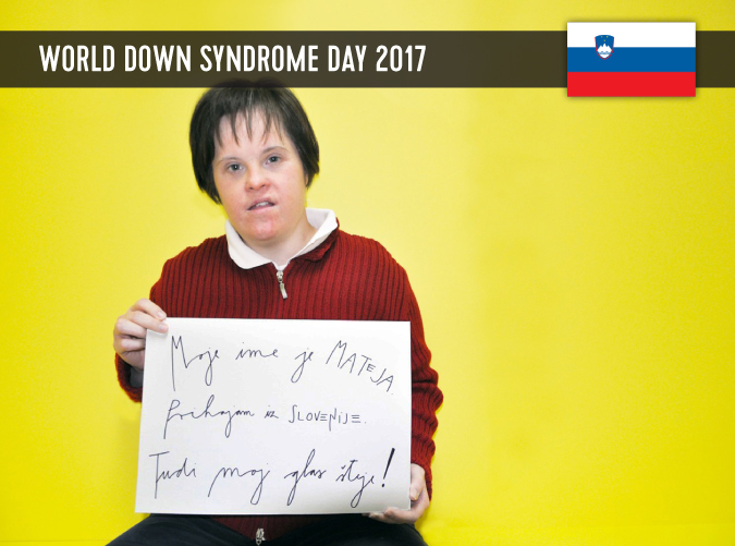 Young Slovenian woman with DS, holding a sign in her hands with a statement on WDSD 2017