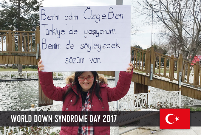 Young Turkish lady with DS holding a sign above her head with a statement on WDSD 2017