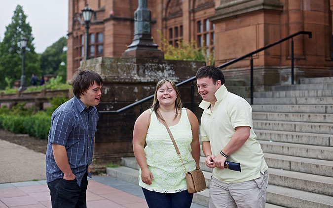 This year's World Down Syndrome Congress Lead Commissioners, Andrew MacIntyre, Sam Ross and Stuart Campbell, all of whom have Down's syndrome, stand in front of Kelvingrove Art Museum in Glasgow