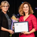 Vanessa dos Santos, president of DSi, presented the award to Emmanuela Zaimi