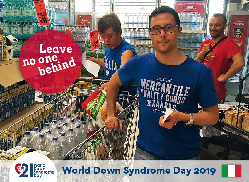 Three young men, one of whom has Down's Syndrome, shopping in a supermarket.